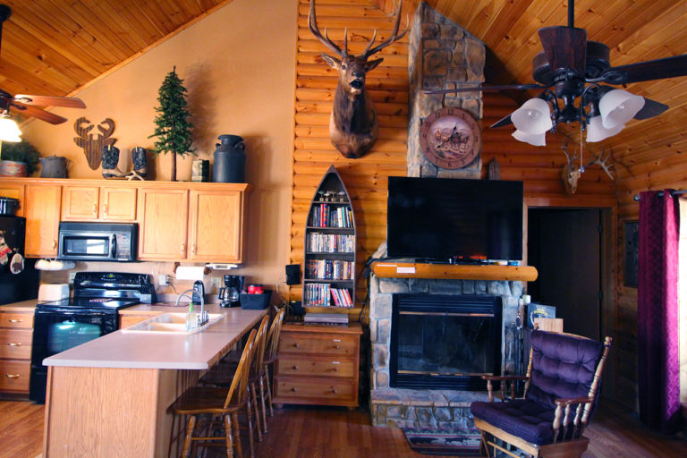 View of Fireplace and Kitchen Old West Log Cabin