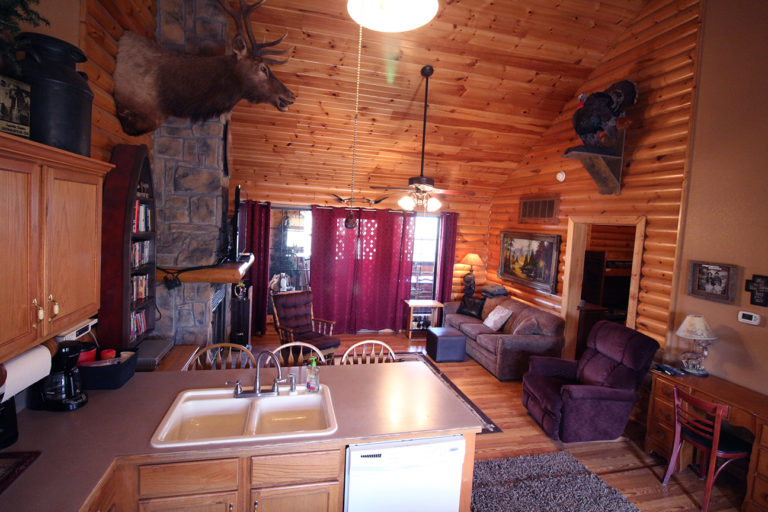 View From the Kitchen to Living Room Old West Log Cabin