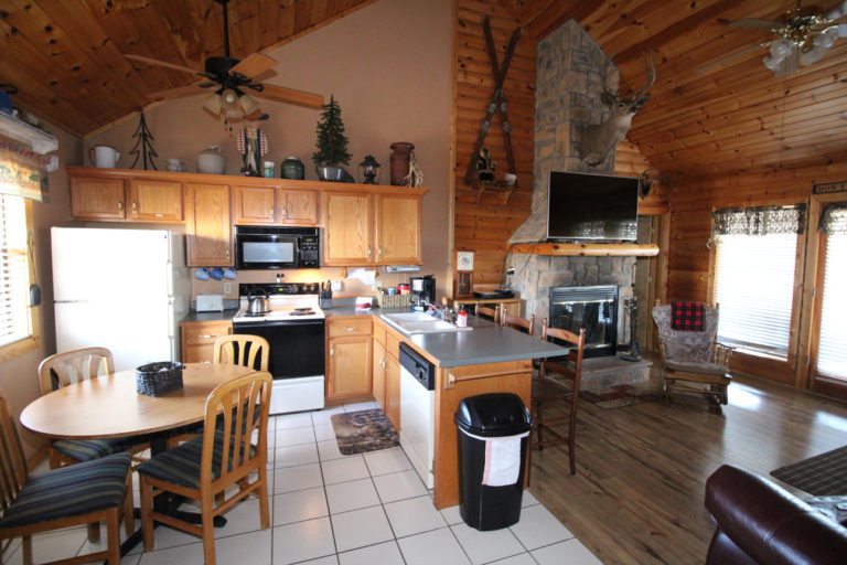 Kitchen and Fireplace Trails End Log Cabin