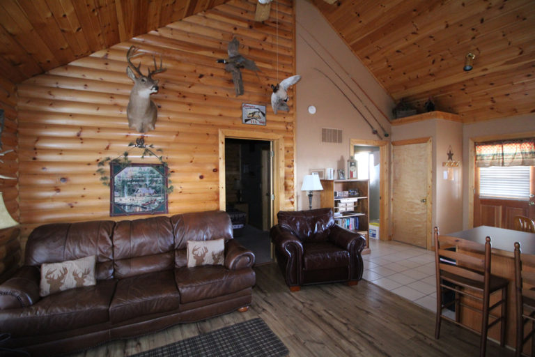 Couches and Recliner in the Living Area Trappers Den Log Cabin