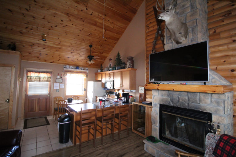 View to the Kitchen From Living Area Trappers Den Log Cabin