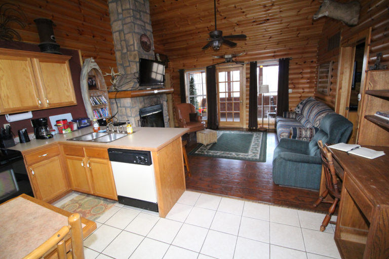 View From Kitchen to Living Area Trails End Log Cabin
