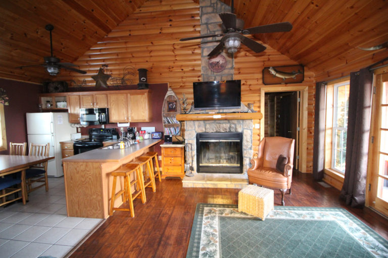 Living Room and Fireplace Trails End Log Cabin