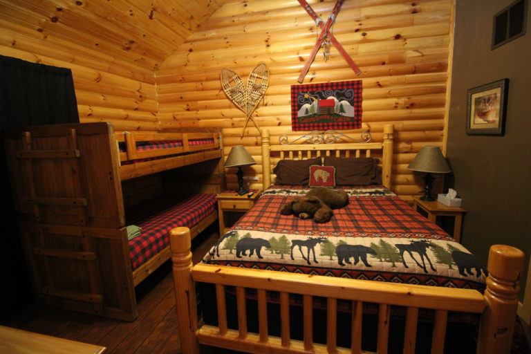 Guest Room with Queen Size Bed and Bunk Beds Trails End Log Cabin