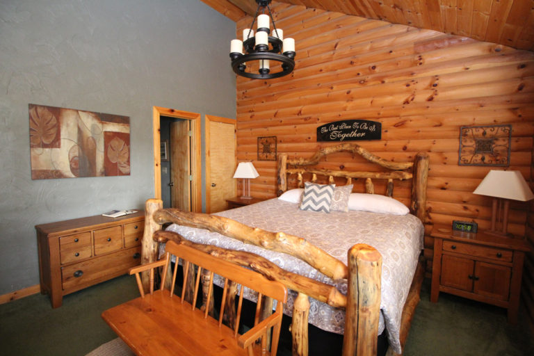 King Size Bed and Bathroom Entrance Serenity Log Cabin
