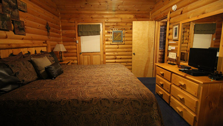 Master Bedroom with King Size Bed View #2 Split Oak Log Cabin