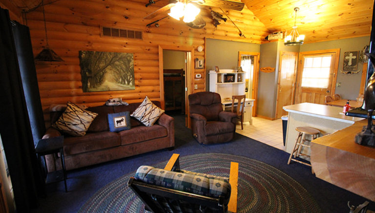 View From Fireplace Toward Cozy Living Area and Bedroom Entrance Split Oak Log Cabin