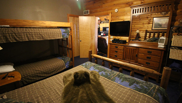 Guest Bedroom With Queen Size Bed and Bunk Beds View #2 Split Oak Log Cabin