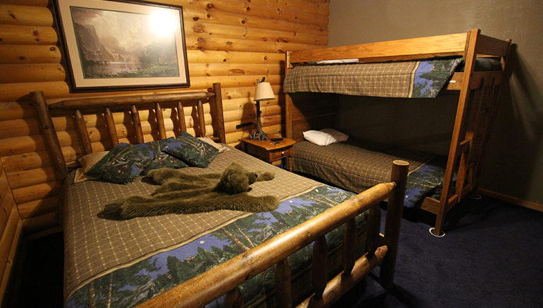 Guest Bedroom With Queen Size Bed and Bunk Beds Split Oak Log Cabin