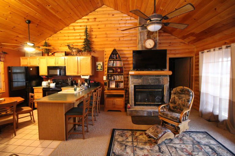 Great Escape Log Cabin Living Room and Kitchen
